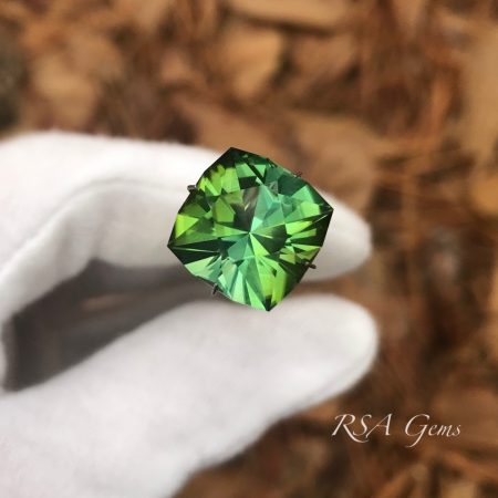 green tourmaline faceted colored gemstone